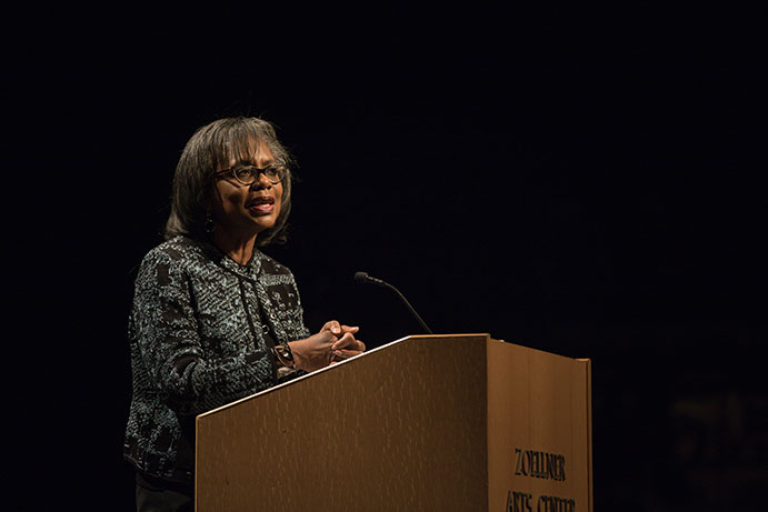 Anita Hill speaking at podium