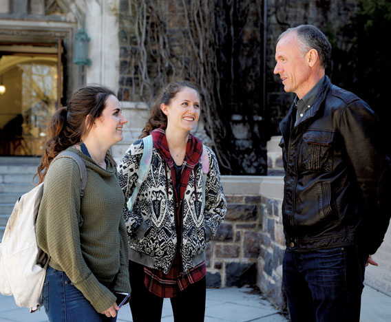 Siobhan '19 and Anna '17, talk with their dad, Tom Gillis.