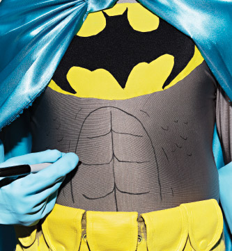 Batman drawing abs on with a sharpie