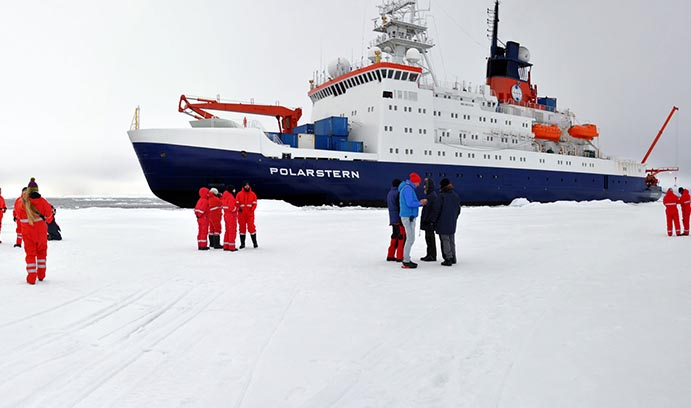 Jill McDermott next to the Polarstern in the Arctic