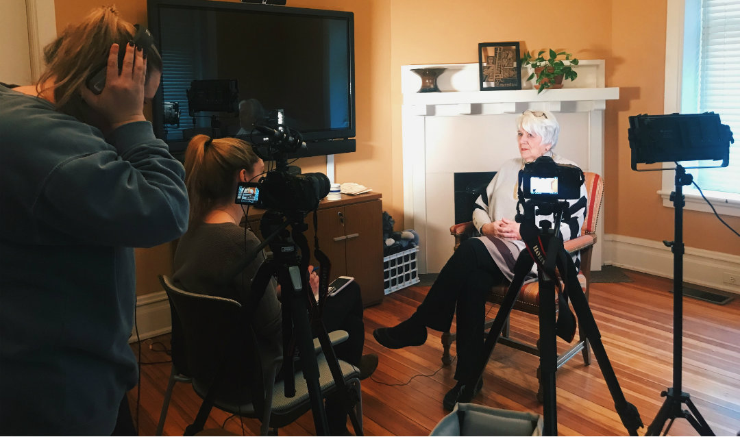 Kari Moffat and Caroline Kelliher interviewing a community member named Connie for their documentary fim