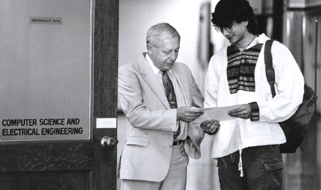 Don Hillman meets with a student