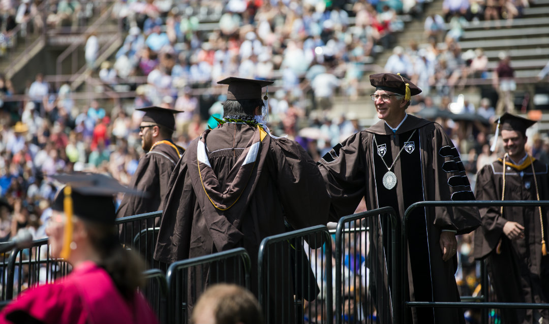 Student shakes President John Simon's hand at Lehigh University commencement