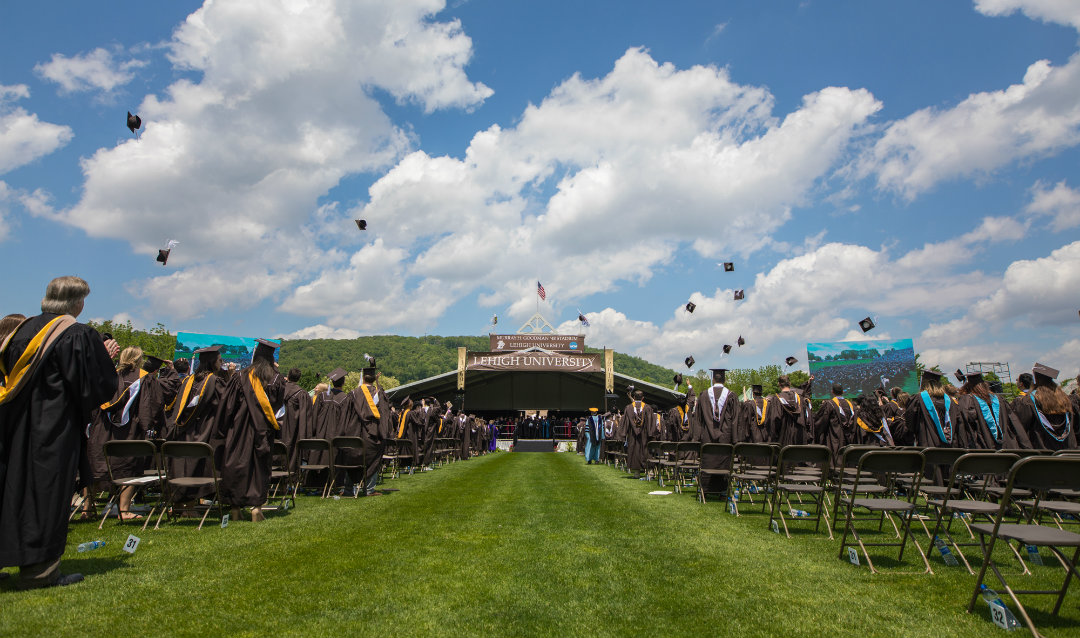 Lehigh graduates toss their caps in the air at commencement