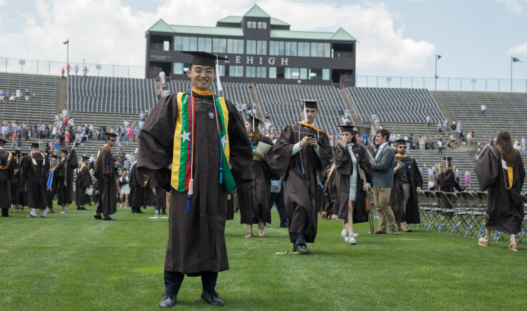 Graduate stands proudly at Lehigh commencement