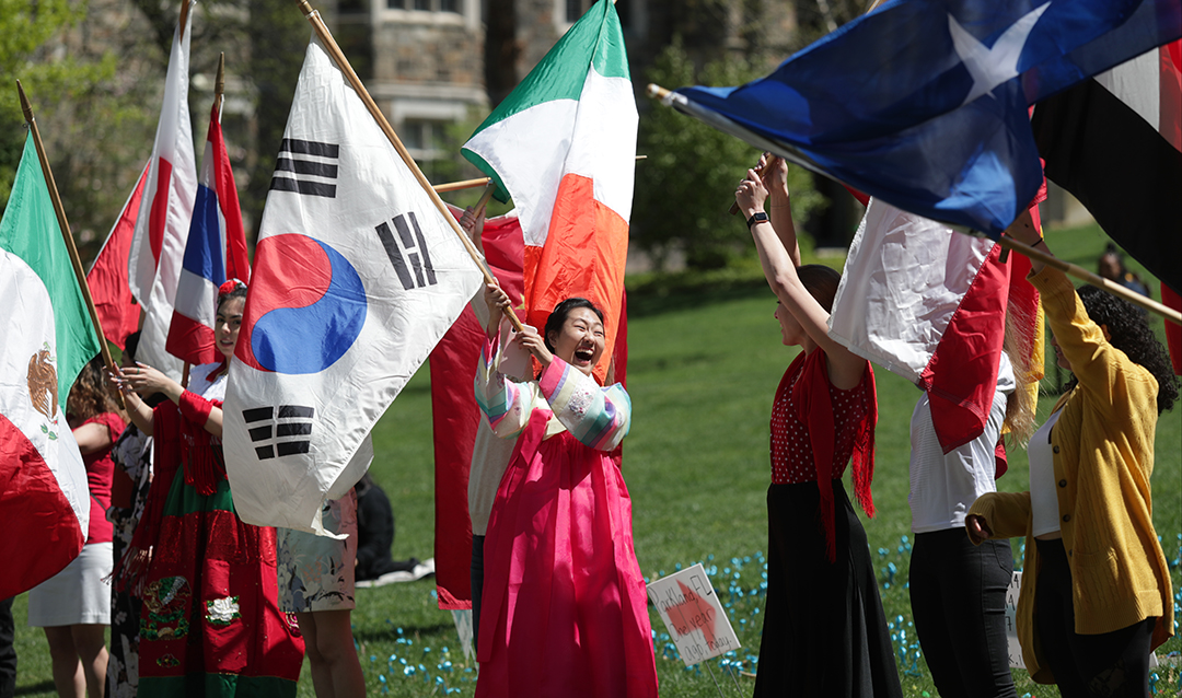 Lehigh students carry their country's flags at the International Bazaar.