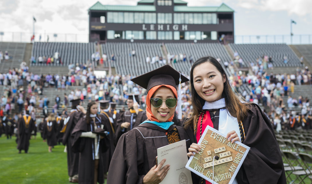 Two female graduates at Lehigh commencement