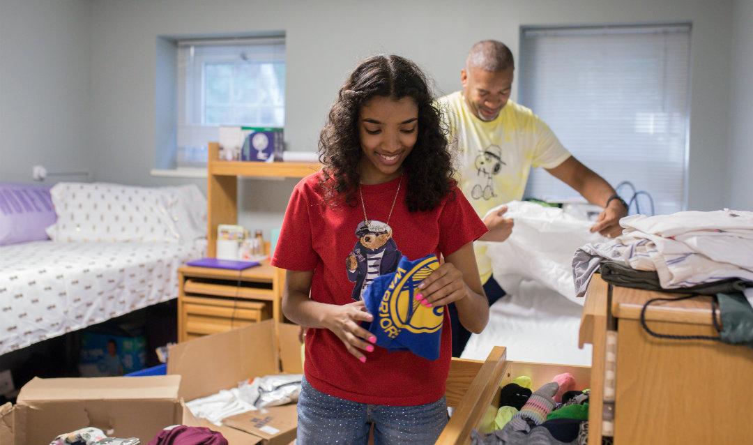 Christina Anglin unpacks in her room in the Umoja House.