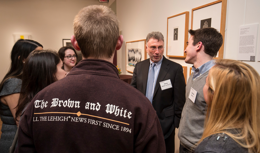 Marty Baron speaking with students on a previous visit to Lehigh
