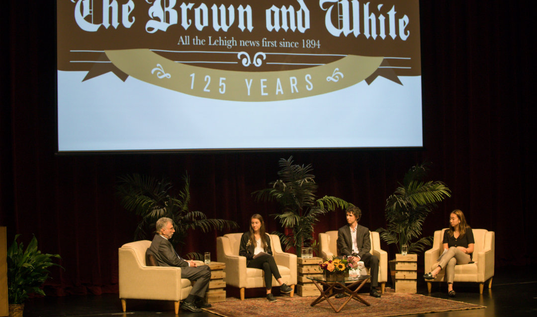 Marty Baron speaks with editors from The Brown and White on stage in Baker Hall