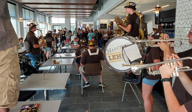The Marching 97 plays inside the new Cafe at FML.