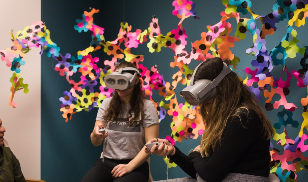 Two female Lehigh students wear VR goggles at CREATIVATE event