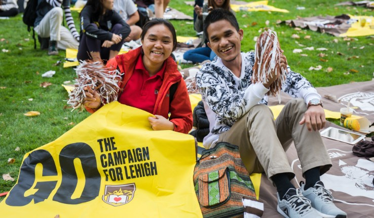 Students sit on blanket at Lehigh University's Brown & White BBQ
