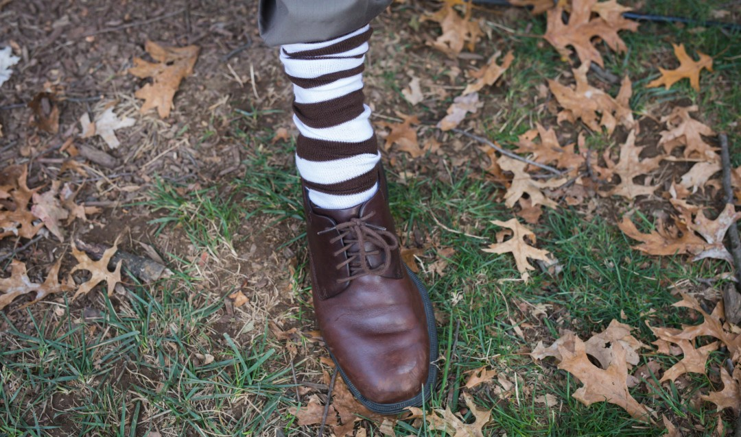Lehigh brown and white socks on a foot at Brown & White BBQ.