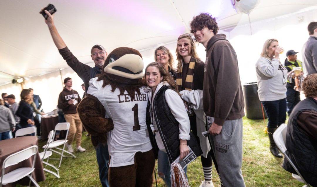 Lehigh University mascot Clutch poses with family at football tailgate