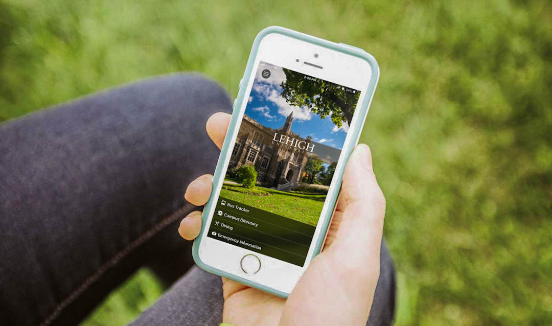 Image of hand holding a smartphone displaying Lehigh University's mobile app