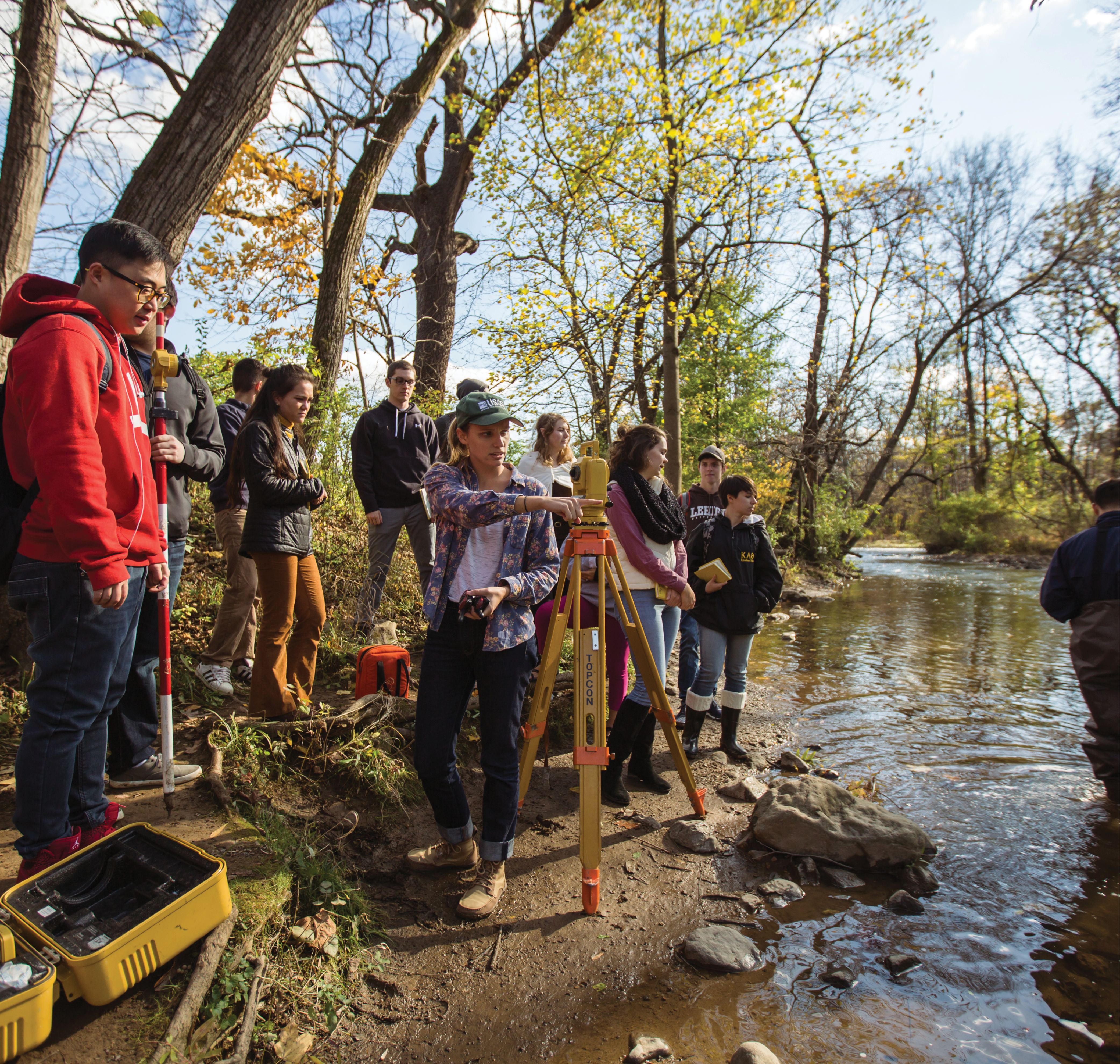 A group of students working at a creek