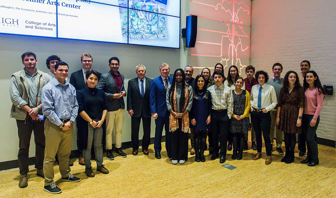 A group of Lehigh University students and professor pose with Charlie Dent