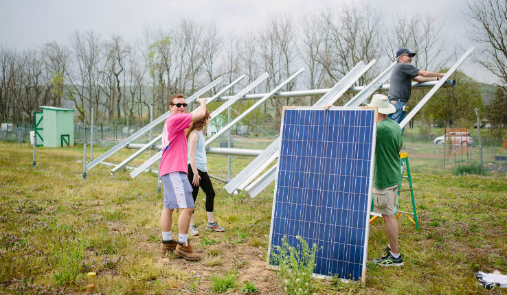 Students on Goodman Campus constructing solar panels