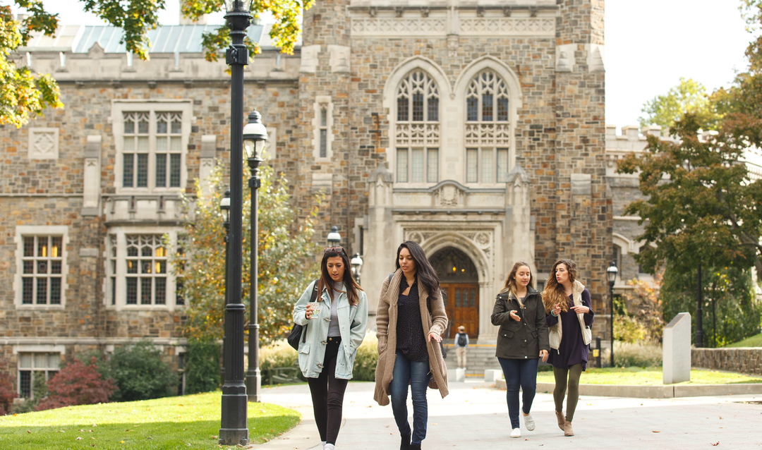 Female Students walk on campus