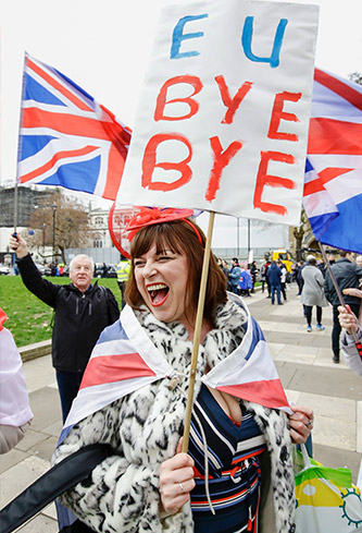 Pro-Brexit woman holds sign at rally