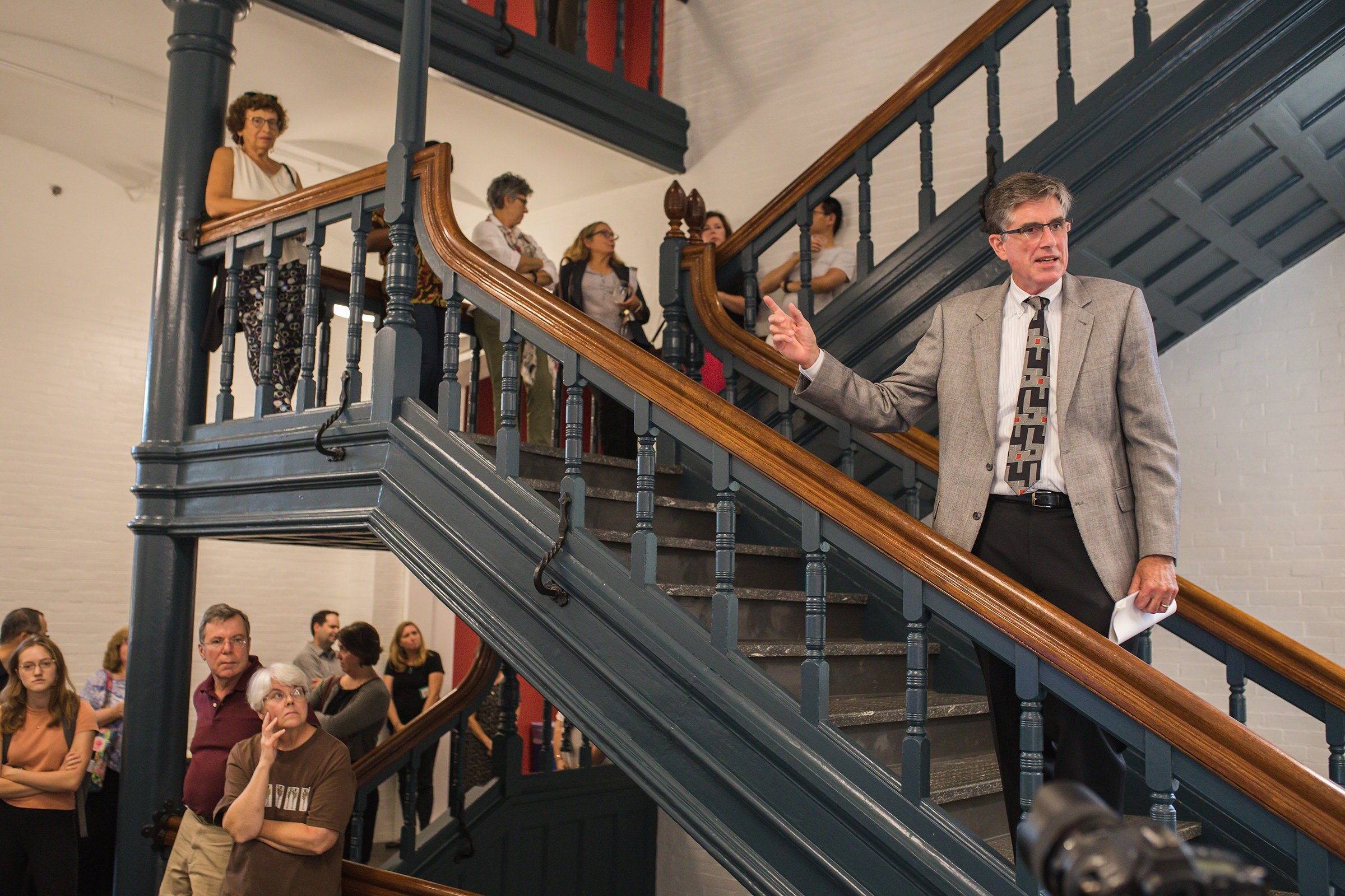 Lehigh Provost Pat Farrell speaks on the staircase at the open house for the newly renovated Chandler-Ullmann Hall.