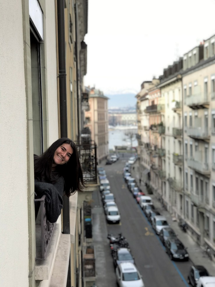 Samantha Margolis in her apartment window in Geneva