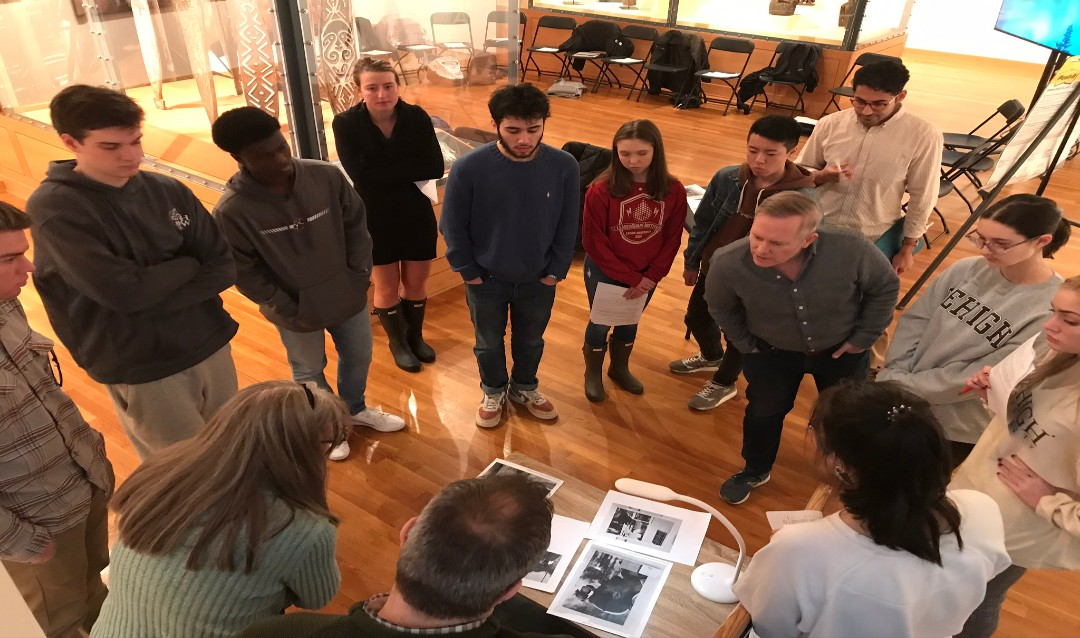 Lehigh students analyzing photographs in spring 2020 as they co-curate the upcoming exhibition Doing Democracy: Photography from the George Stephanopoulos Collection.