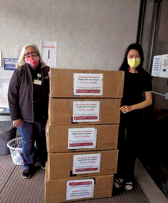 Elizabeth Cao '21 (right) drops off masks at Lehigh Valley Health Network.