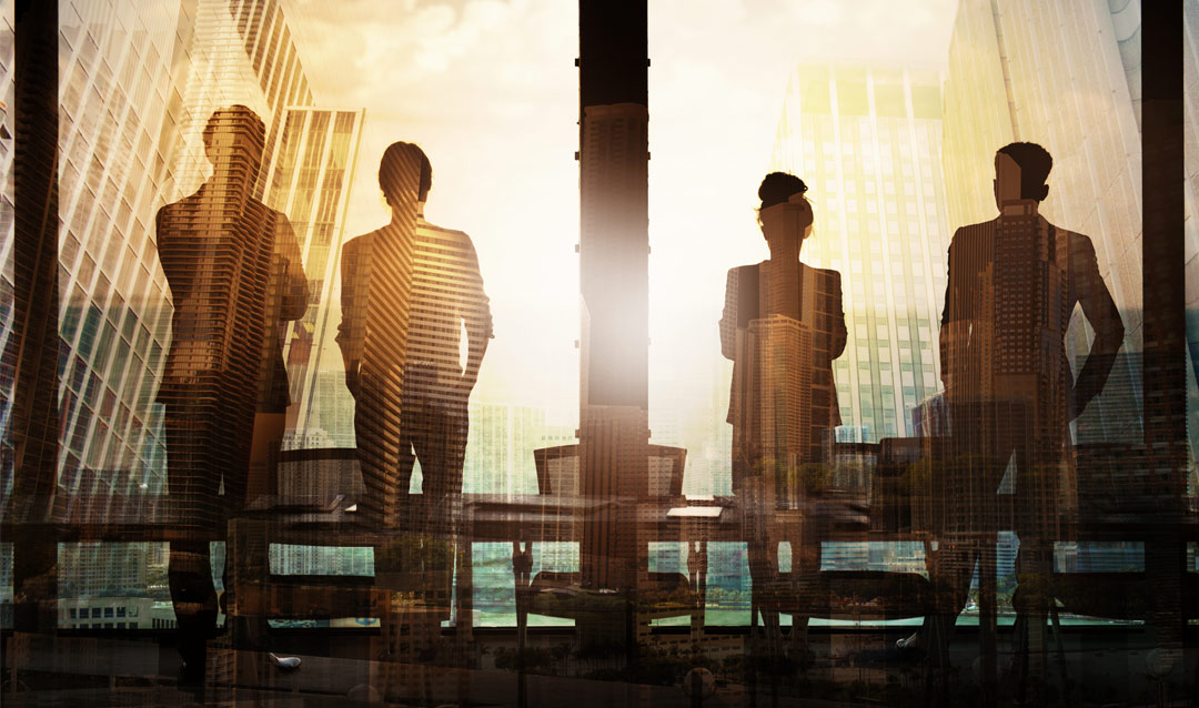 Silhouettes, including a woman, in an office