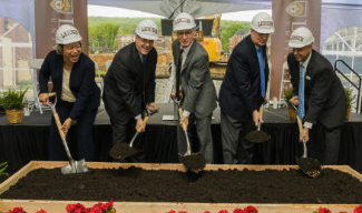 University leadership break ground at SouthSide Commons