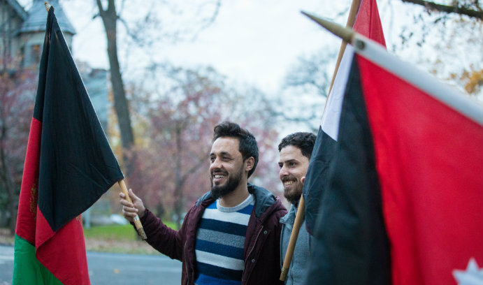 two students holding flags